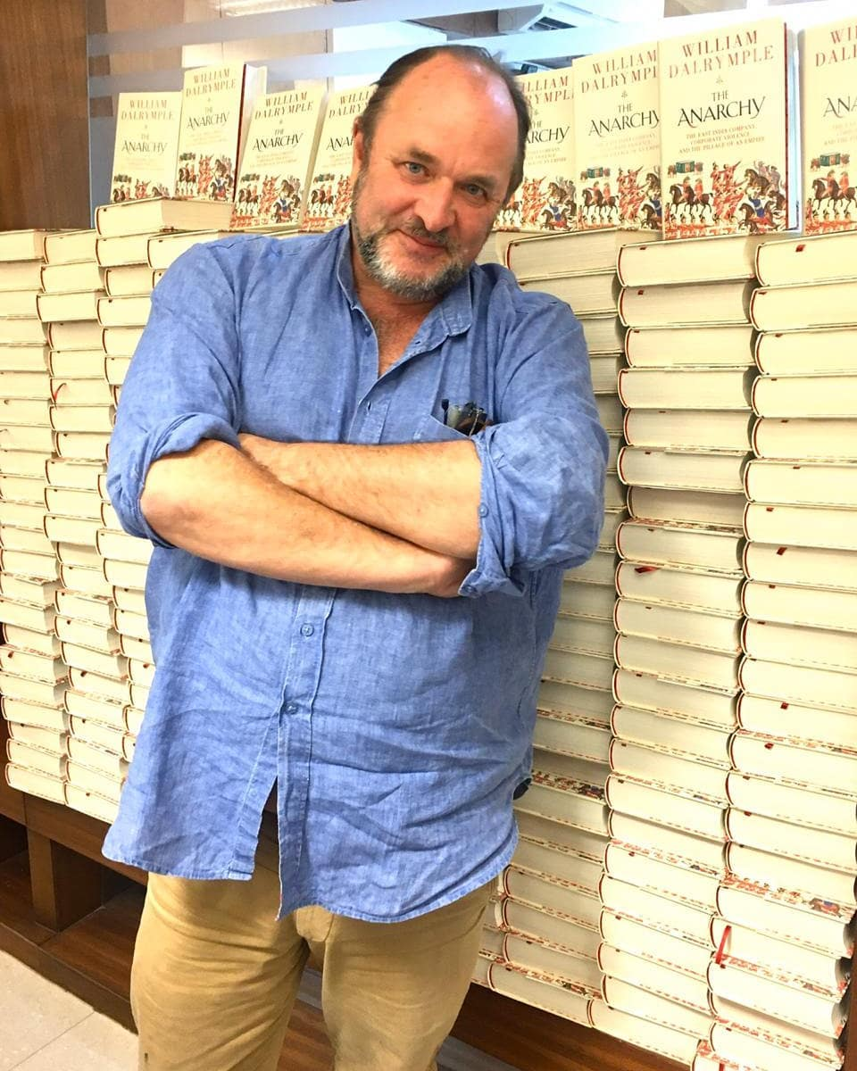 The author poses with his book Anarchy: The East India Company, Corporate Violence, and the Pillage of an Empire