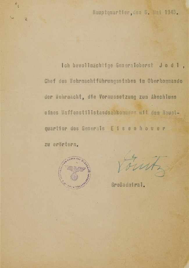 Letter given to Field Marshal Alfred Jodl. His official credentials allowing him to negotiate Germany's surrender in World War II with the Allies. Signed by Karl Donitz, president of Germany, Source