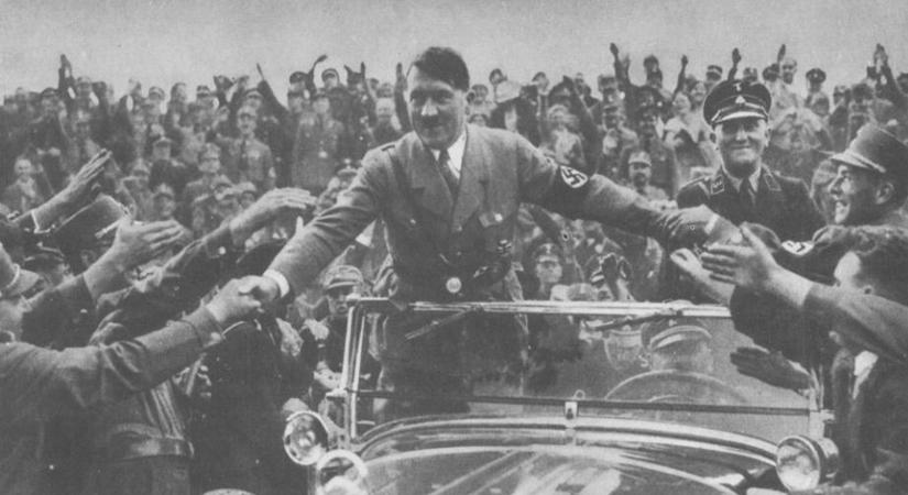 Adolf Hilter in a car, Source - hitler.org