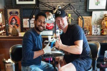 Celebrity tattoo artist Vikas Malani and former Australian cricket captain Michael Clarke.